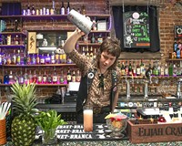 Paul Kirk, bar manager at Fuzzy Cactus, pours a Zombie Bird cocktail.