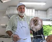 Alvin Miller holds up a massive doughnut from Mrs. Yoder's Kitchen.
