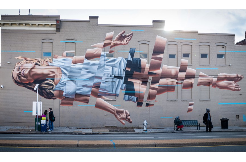 "Artist: James Bullough; Location: Broad and Lombardy; The artist notes in the book interview that he tries to avoid answering questions about what his art means. ""I feel that the point of public art is to create something that gets people to think themselves and come up with their own ideas of what the art is or says to them. Some of my favorite moments, when I am painting murals, are listening to people on the street watching me paint and discussing their different thoughts about the work."" - PHOTO COURTESY ""MURALS OF RICHMOND"""