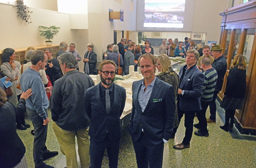 Peter Culley, founder and principal of Spatial Affairs Bureau architecture and planning firm, and Ted Elmore, BridgePark director, at Mobelux with the project model prior to their presentation to architects and planners Nov. 8. - SCOTT ELMQUIST