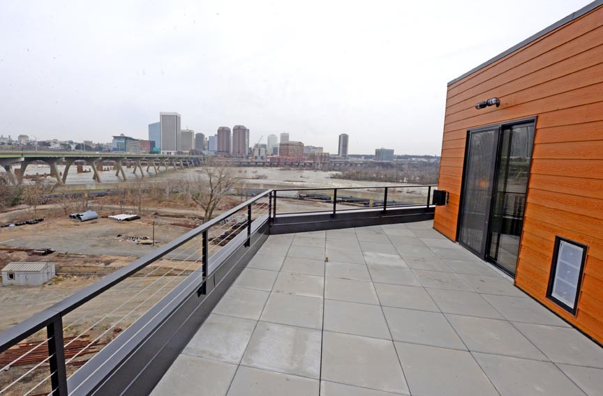 Perhaps the greatest asset of the luxury town home in Manchester is its location, with breathtaking views of the James River and Richmond's skyline. From the rooftop patio, the rush of the James River falls can be heard. - SCOTT ELMQUIST