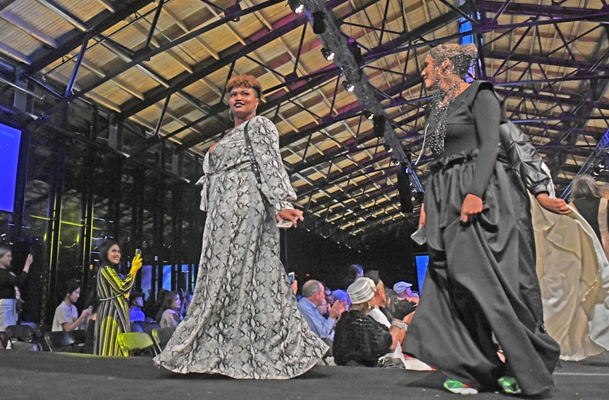 Senior design student Taylor Virgil walks with senior Sarah Elsadig who also showcased her collection during the 50th annual VCUarts juried fashion show. - SCOTT ELMQUIST