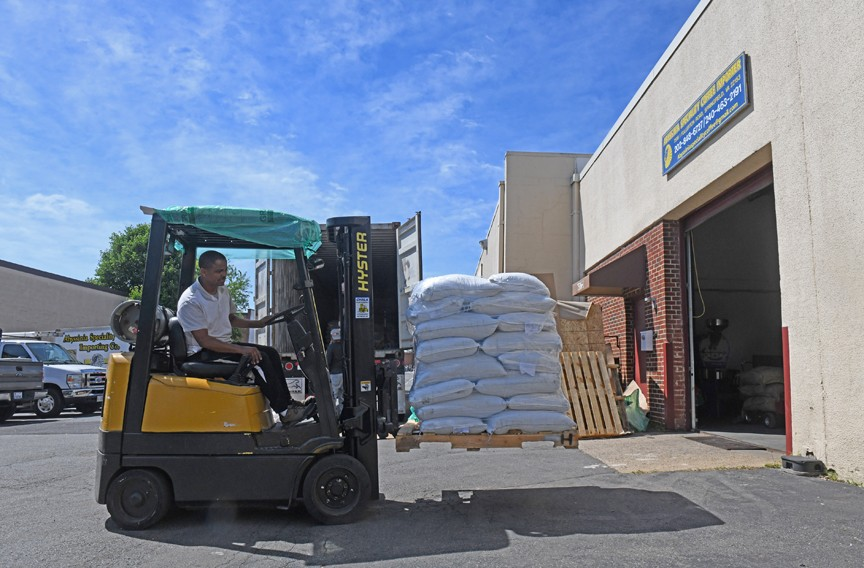 Bags of coffee beans are transported at the 734 Coffee warehouse in Springfield. The coffee is known for its smooth, robust flavor and comes from a region of Northeast Africa that produces some of the world's best coffee beans. - SCOTT ELMQUIST