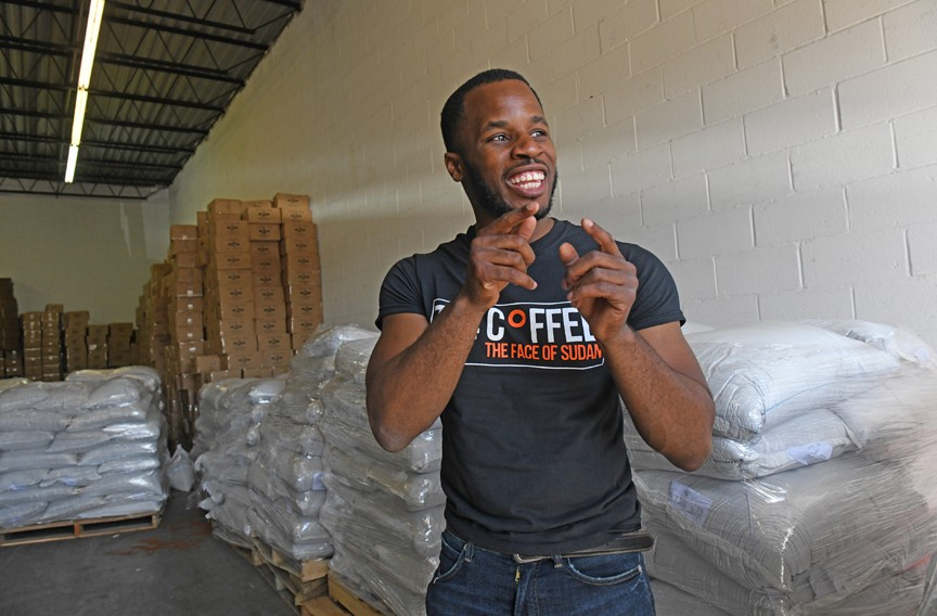 Akandu Nwosu, the marketing manager for 734 Coffee, boasts that people who try the coffee will come back for more. He calls Kher an inspiration for anyone who needs hope. - SCOTT ELMQUIST