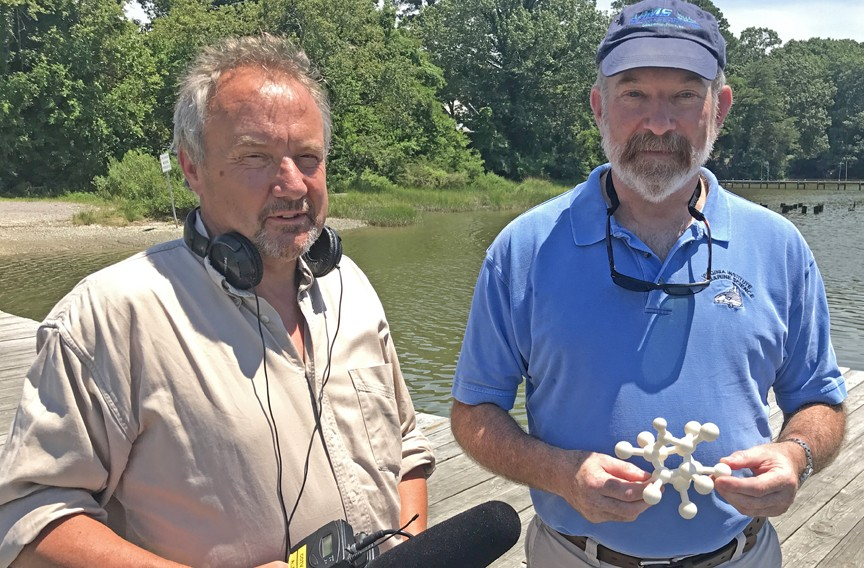 Professor Michael A. Unger, right, of the Virginia Institute of Marine Science, holds a 3-D model of Kepone made by filmmaker Bernard Crutzen. - JASON ROOP