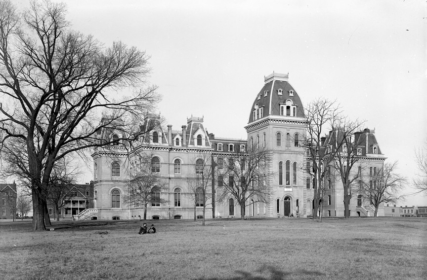 """The main building of Richmond College, shown in about 1900, dominated the campus near what is now the intersection of Lombardy and West Grace streets. In 1914 the men's school moved to the Westhampton neighborhood, where it was newly admitting women, it reopened as the University of Richmond. Today, the 1100 block of West Grace is lined with numerous student apartment buildings which have earned the stretch the moniker of """"hell block."""" - THE VALENTINE"""