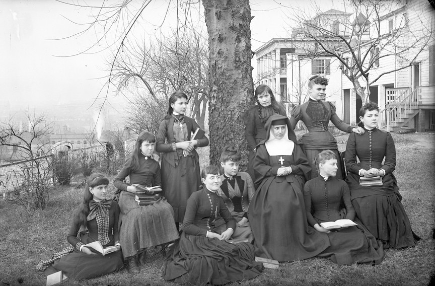 A sister and students at the Monte Maria Academy, a private school operated by the cloistered Sisters of the Visitation of Mary, posed in this undated photo in the late 19th or early 20th century, on the southwest ridge of Church Hill looking toward Shockoe Bottom. The convent later moved to Hanover County. The Richmond Hill retreat center now occupies the complex. - THE VALENTINE