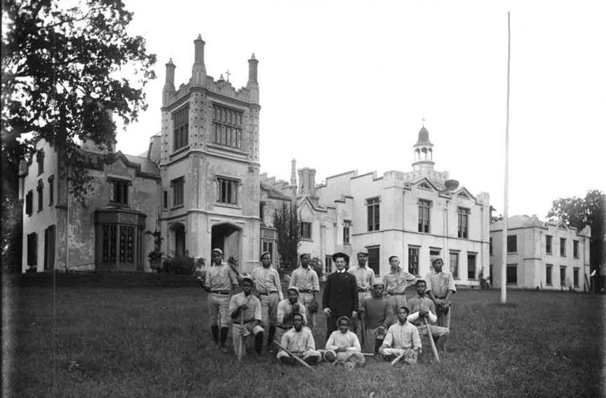The baseball team of St. Emma Industrial and Agricultural Institute in Powhatan County pose in the early 20th century in front of Belmead. The former plantation house, which still stands, served the private African-American boys school for 77 years. - THE VALENTINE
