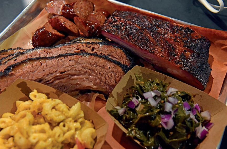 ZZQ serves up beef brisket and pork spare ribs with sides such as collard greens and jalapeño mac and cheese. - SCOTT ELMQUIST/FILE