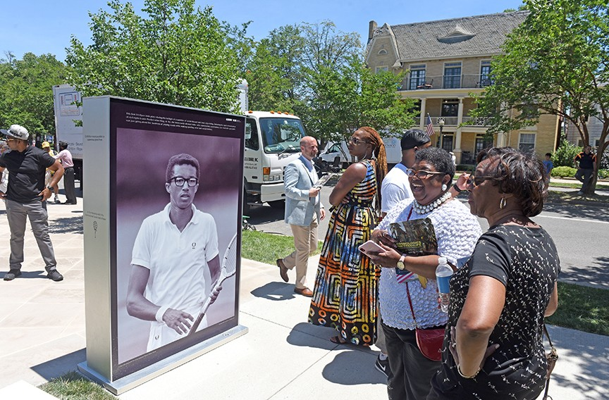Crowd members stand outside during the Arthur Ashe Boulevard renaming ceremony. - SCOTT ELMQUIST