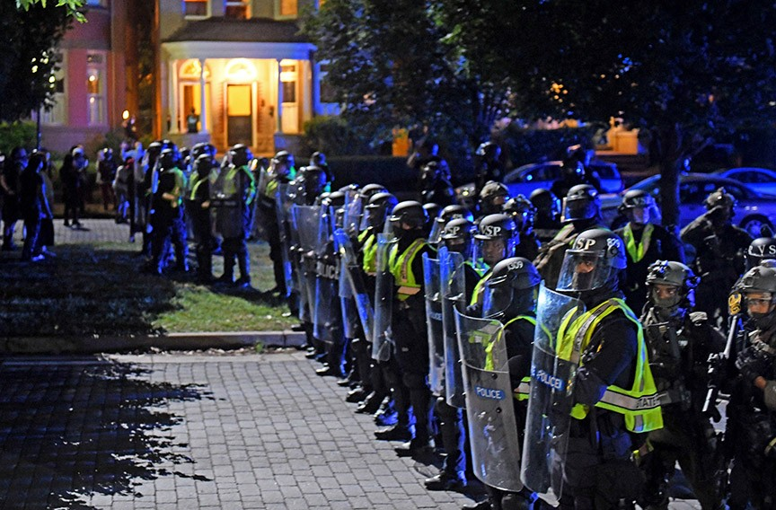A phalanx of state troopers blocks Stuart Circle after launching tear gas and rubber bullets at protesters June 21. - SCOTT ELMQUIST