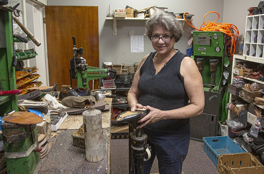 Cynthia Kalfoglou, a cobbler and the proprietor of Gus's Shoe Repair at 528 E. Main St., has shifted to boot repairs and mending zippers during the pandemic. - SCOTT ELMQUIST