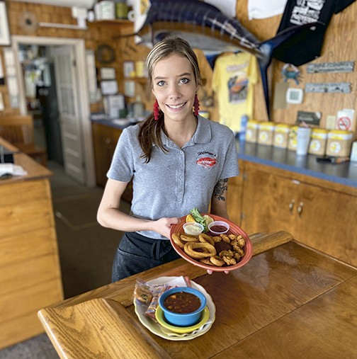 Kara Allison serves a lunch at Wilkerson's restaurant, a riverfront destination on McKinney Boulevard. - SCOTT ELMQUIST