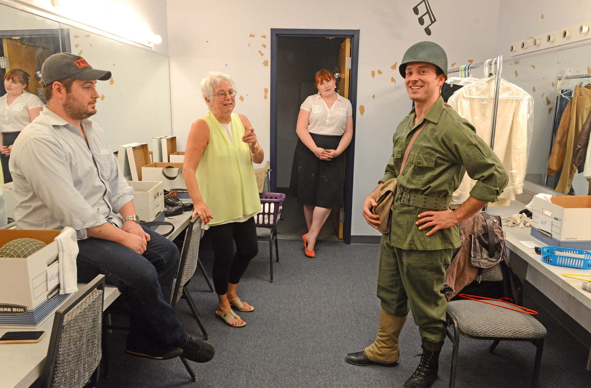 Director Kniffen sits in on a fitting for actor Alexander Sapp, right, with costume designer Sue Griffin and costumer Ruth Hedberg. - SCOTT ELMQUIST