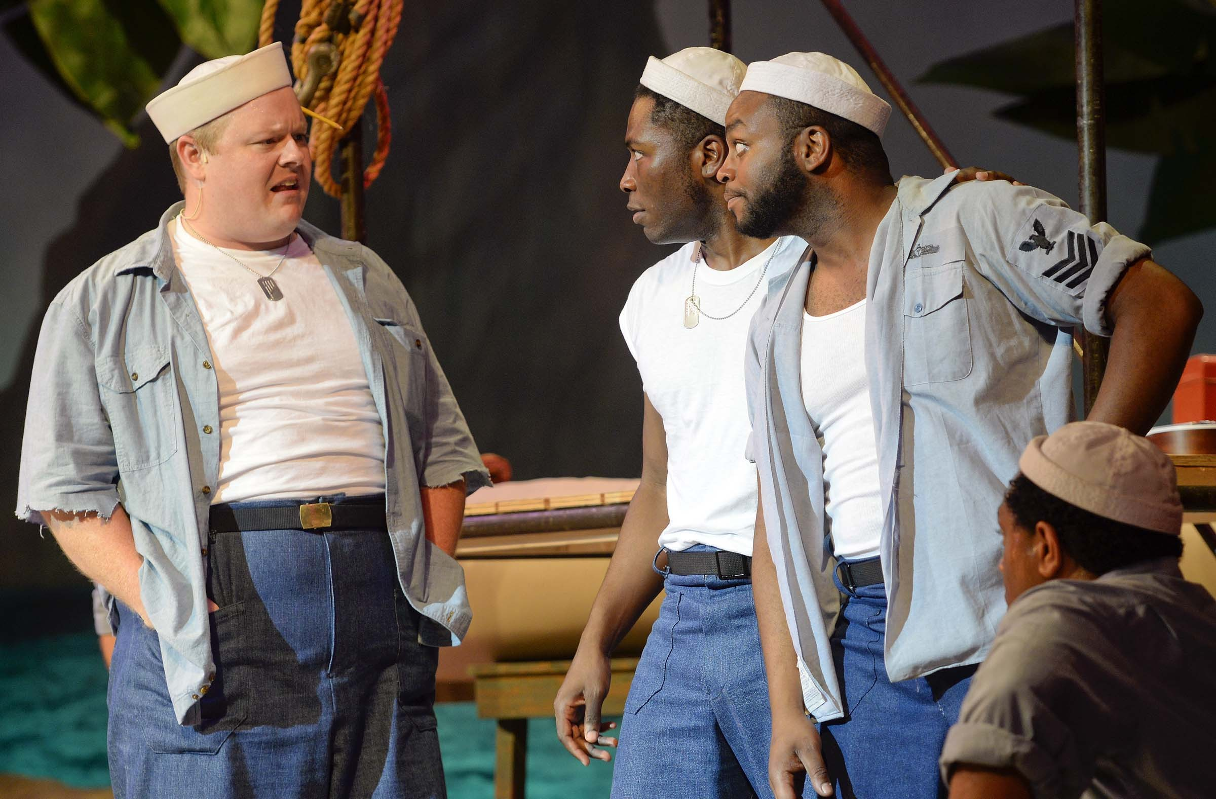 Paul Major, who plays Stewpot, banters with fellow Seabees, played by Jamari Johnson Williams and Durron Marquis Tyre. - ASH DANIEL