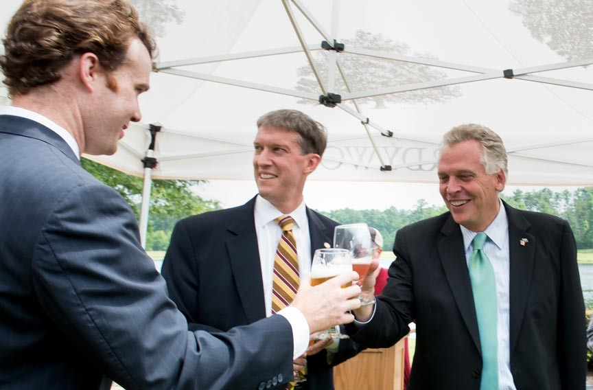 Department of Agriculture and Forestry Secretary Todd Haymore and Gov. Terry McAuliffe toast at the announcement of Hardywood Park Craft Brewery's expansion west of Richmond. - PIERRE COURTOIS/LIBRARY OF VIRGINIA