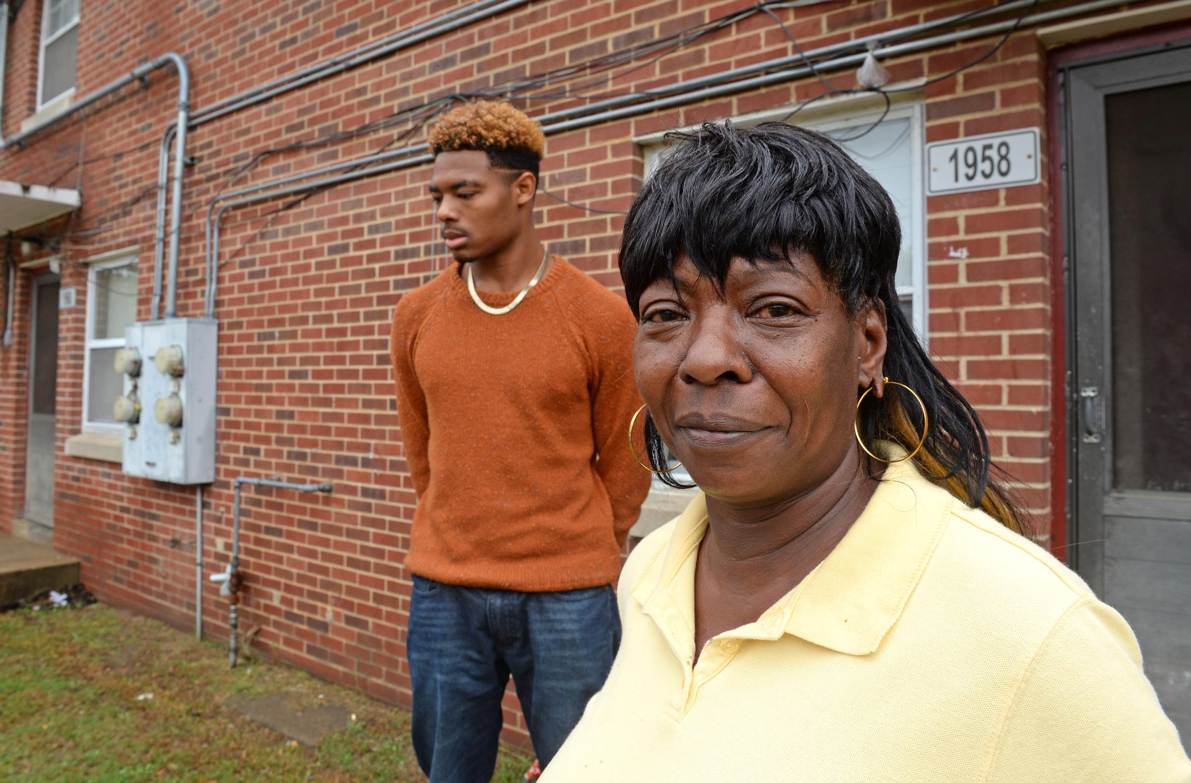 Dominique Crutchfield, 18, stands with his grandmother, Darlene Crutchfield outside of her apartment in Mosby Court. Dominique's father, who was Darlene's son, became the sixth homicide victim in the public housing project this year. - SCOTT ELMQUIST
