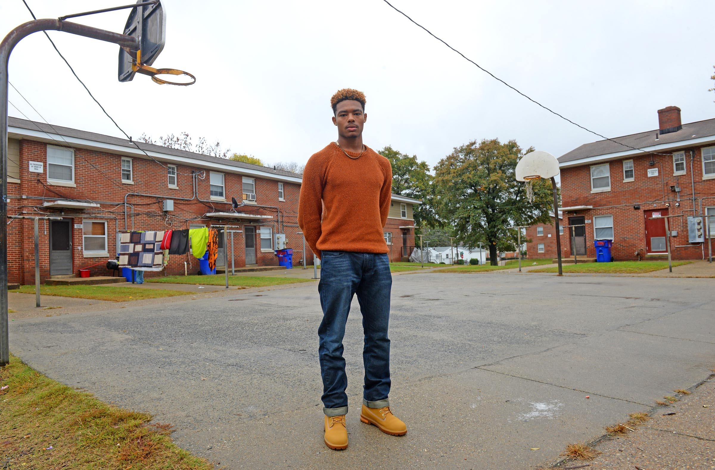 Dominique Crutchfield stands in the basketball court where he joined his family for the vigil of his late father, William Crutchfield. As the oldest of six siblings, the 18-year-old says he now stands in for his father in many ways. He hopes to attend a Virginia college. - SCOTT ELMQUIST