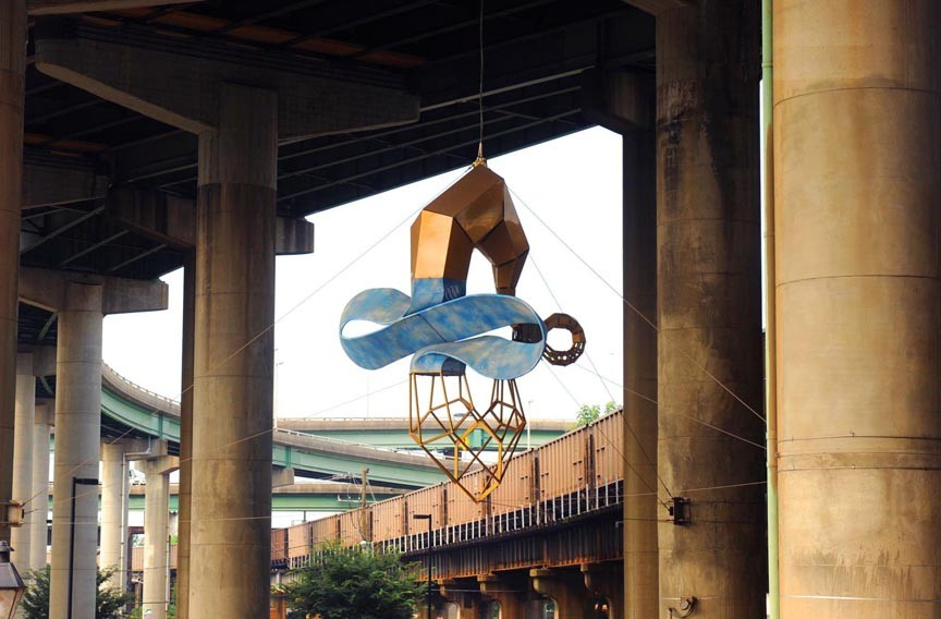 """There could be much more public art across the city, such as """"Skyrider,"""" a 2003 sculpture by John Newman hanging near Main Street Station. - SCOTT ELMQUIST"""