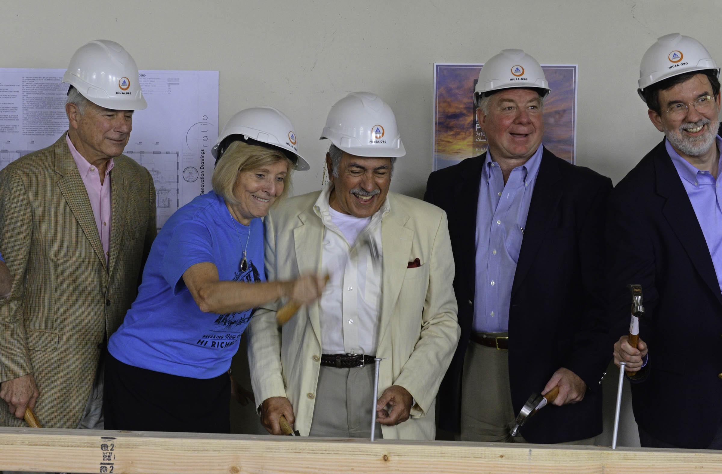 Not far away from Quirk, a $2.8 million hostel opened in 2015 at 7 N. Monroe St. The year before, Jim Ukrop, left, joins Faye Hager of Virginia Capital Realty during a ceremonial groundbreaking. Ukrop helped give the decade-old project some traction. - SCOTT ELMQUIST