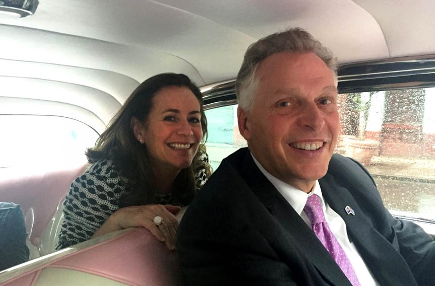Virginia's first couple pose in a 1956 Chevrolet during a cultural and trade mission to Cuba earlier this month. - TWITTER