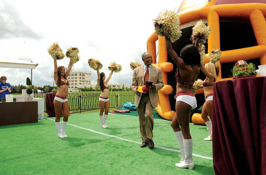 Jones makes an entrance on the field of the Bon Secours Washington Redskins Training Camp during its grand opening in July 2013. The city sunk $11 million into the facility, taking a risk for the promise of a heightened profile and increased development. - SCOTT ELLMQUIST