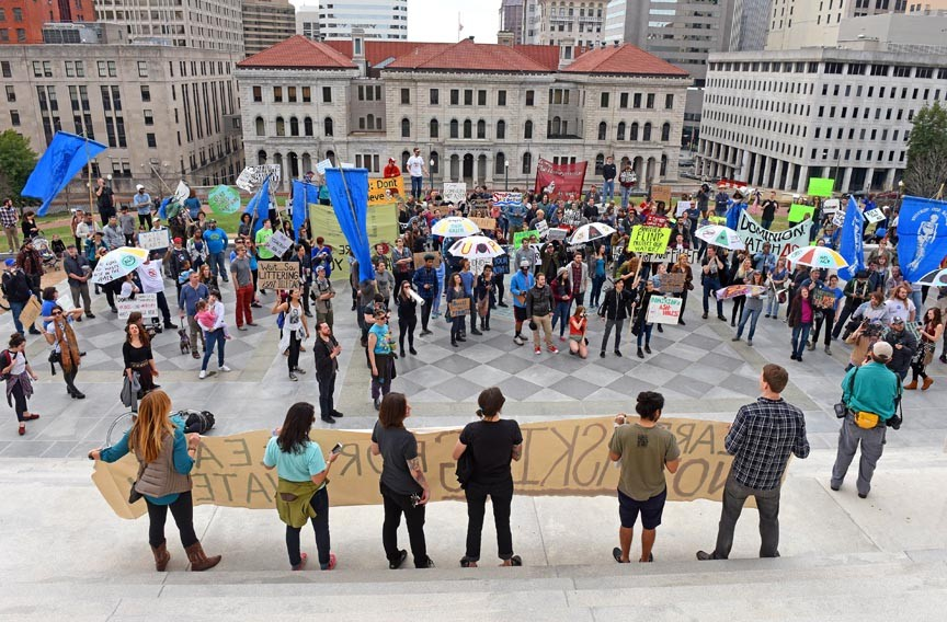 Protesters gather at the steps of the State Capitol on Feb. 20 to demonstrate against Dominion Virginia Power and its plans to dump treated coal ash wastewater into the James River and a creek flowing into the Potomac River. - SCOTT ELMQUIST
