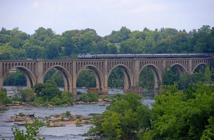 An Amtrak train crosses the famous Atlantic Coastline Bridge over the James River. - SCOTT ELMQUIST