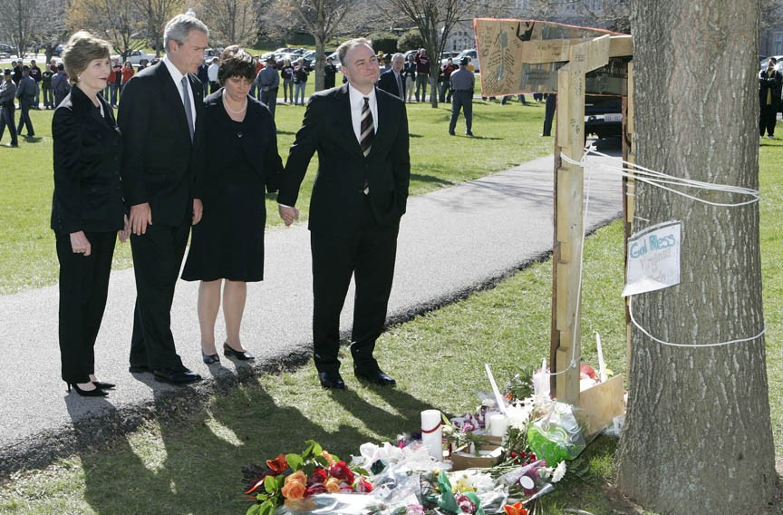 After the April 16, 2007, mass shootings at Virginia Tech, which killed 32, Kaine immediately returned from a trade mission in Japan to console members of the Tech community. He and his wife, Anne Holton, right, stand with Laura Bush and then-President George W. Bush. - REUTERS/LARRY DOWNING