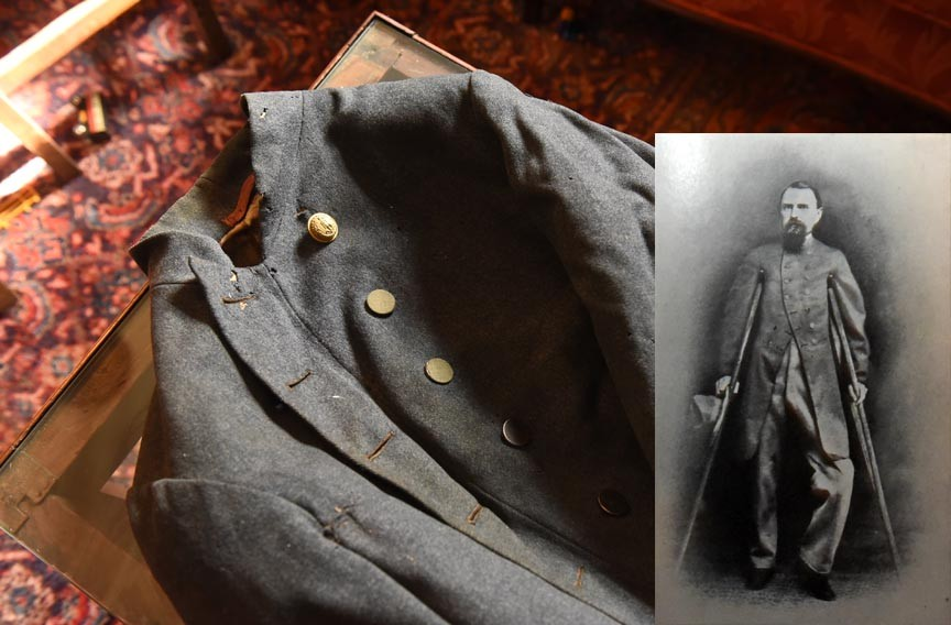 This Confederate army coat once belonged to John H. Worsham, which he wore in the photograph at right. It was among items found in a long locked trunk. He was the first of six generations to live at 3601 Brook Road. - SCOTT ELMQUIST