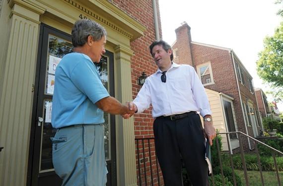 Former city councilman Jon Baliles, right, campaigns door to door in September. - SCOTT ELMQUIST