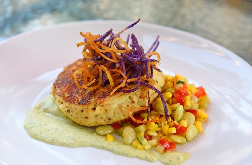 Atop succotash sautéed in bacon fat, Julep's crab cake encapsulates the best of Virginia seafood. - SCOTT ELMQUIST