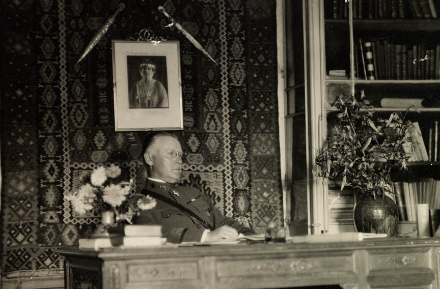At his Red Cross office in Romania, Henry Watkins Anderson works below a portrait of Queen Marie — not his fiancée, Ellen Glasgow. - VIRGINIA HISTORICAL SOCIETY