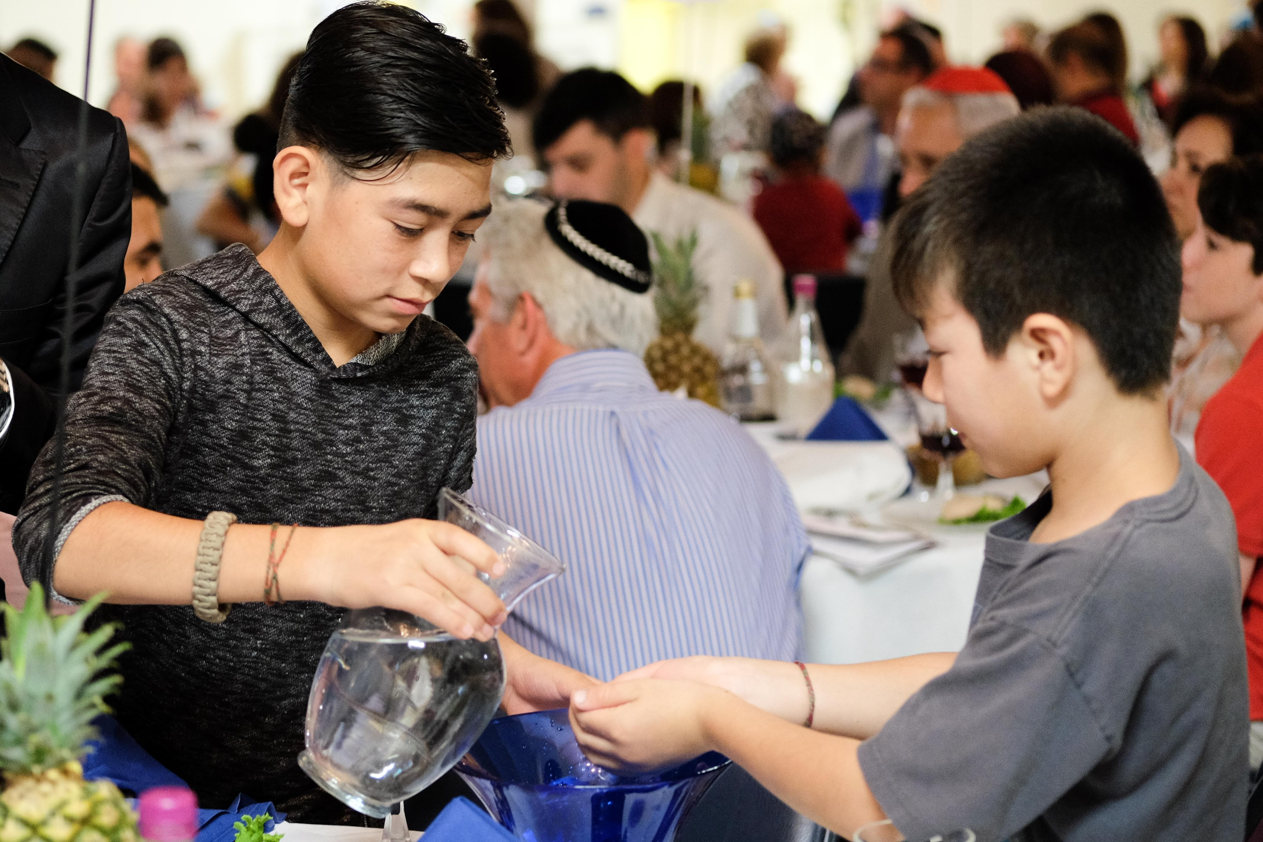 Organized with ReEstablish Richmond, a nonprofit dedicated to refugee resettlement services, the synagogue hosted the Seder for around 275 people. - JACKIE KRUSZEWSKI