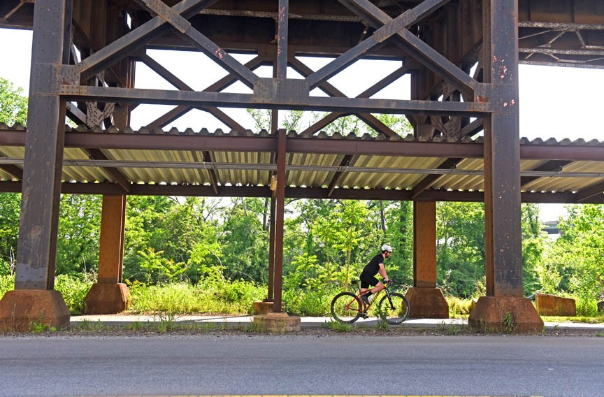 The path under the train tracks along Dock Street now marks the beginning — or end, depending where you start — of a 52-mile bike and pedestrian path to Williamsburg. The trail is one of many bike infrastructure projects completed in Richmond in recent years. - SCOTT ELMQUIST