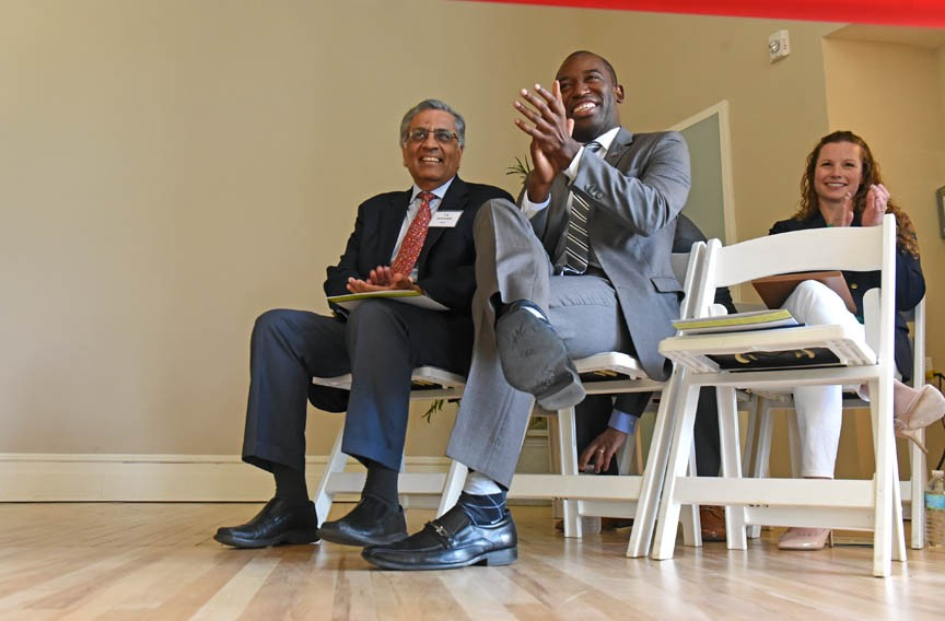 T.K. Somanath, head of the Richmond Redevelopment and Housing Authority, and Mayor Levar Stoney sit together at the ribbon-cutting ceremony for the Highland Park Senior Apartments. - SCOTT ELMQUIST