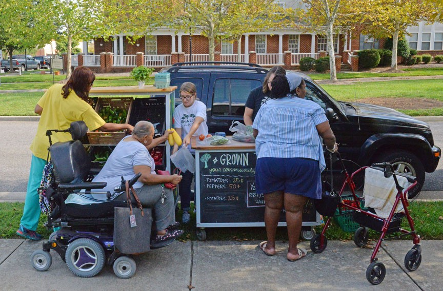 "Senior residents at Winchester Green Apartments on Jefferson Davis Highway line up to buy produce at a mobile distribution market. ""We don't have any stores around this area who sell fresh fruits and vegetables,"" says Lillie Robinson. - SCOTT ELMQUIST"