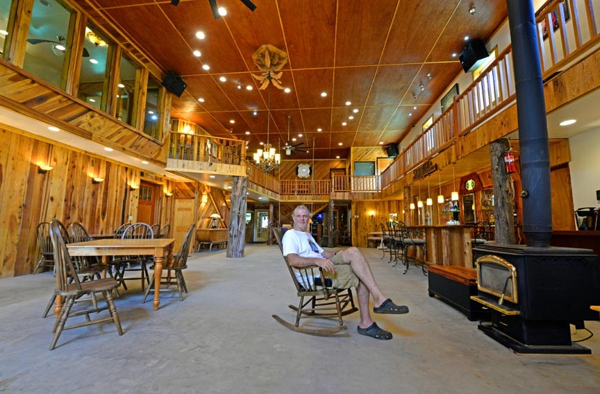 David VanDerveer, the owner of vacation properties at the White Lotus Eco Spa Retreat, sits inside a communal building for his guests dubbed the Zen Barn. - SCOTT ELMQUIST