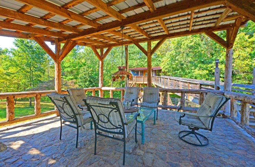A gazebo leads to a treehouse at the White Lotus Eco Spa Retreat, where vacation homes are tucked away in the woods but just miles from the scenic views of the Skyline Drive. - SCOTT ELMQUIST