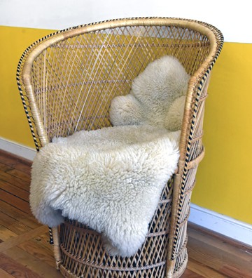 A wicker low-back peacock chair - SCOTT ELMQUIST