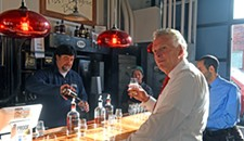 McAuliffe Works to Keep Spirits Up in Virginia's Growing Distillery Industry