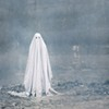 "Movie Review: ""A Ghost Story"" Explores What Happens When a Spirit Is Haunted by the Living"