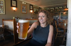 Employee and resident beer expert Leslie Yates says the increase in sales since the opening of the trail has allowed the owners to add eight taps of local brews to the bar. - SCOTT ELMQUIST