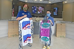SCOTT ELMQUIST - Employees at Puritan Cleaners have to bag more than just clothes these days.