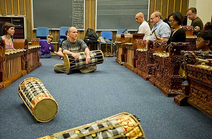 University of Richmond ethno-musicologist Andrew McGraw, center, leads Gamelan Raga Kusuma, a community group that utilizes handmade instruments to perform music normally used in Indonesian rituals. - ASH DANIEL