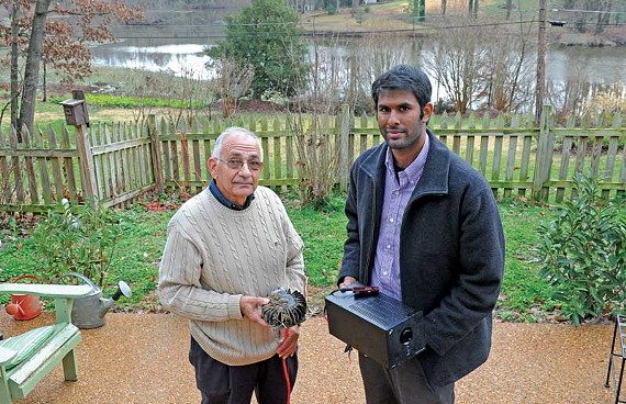 VCU scientists Ray Gargiulo and Tarun Sinha hold the device they developed to repel geese with sound. The transducer (left) transmits low-frequency vibrations into the ground. - SCOTT ELMQUIST