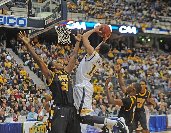 VCU's Treveon Graham holds his position against Drexel's Damion Lee during the CAA championship. - SCOTT ELMQUIST
