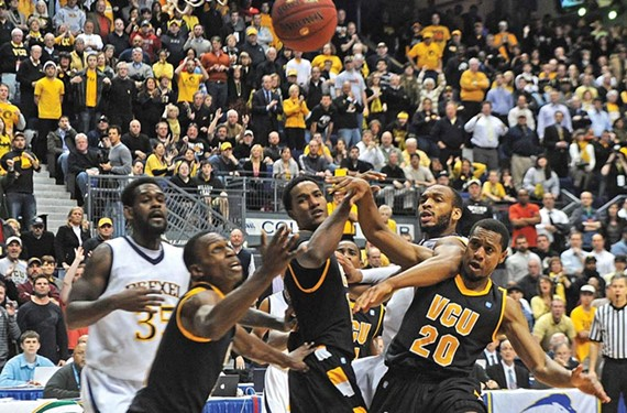 VCU's Treveon Graham, Juvonte Reddic and Bradford Burgess battle for a rebound during the Rams' victory over Drexel in the Colonial Athletic Association championship. - SCOTT ELMQUIST