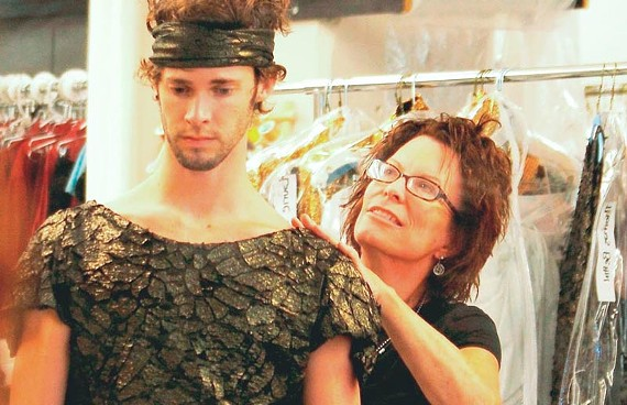 "Virginia Opera's Pat Seyller puts Richmond Ballet's Thomas Volpe Bettin in costume for his dancing role in ""Aida, slated for CenterStage on Oct. 21 and 23. - VIRGINIA OPERA"