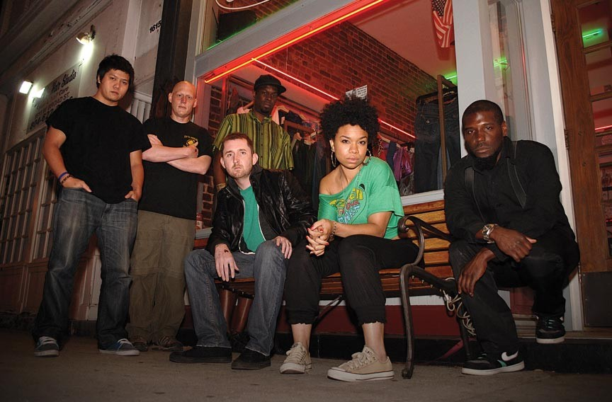 """We put a lot of thought into what comes out of our mouths."" Photosynthesizers are, from left, Phillip ""Dr. Data"" Nguyen, Wade Puryear, Joshua Bryant (seated),  Mike ""Mikemetic"" Williams, Samantha ""SamSun"" Hewlett and Maurice ""Barcodez"" Jackson. Keyboardist Puryear has since been replaced by Chelsea Temple."